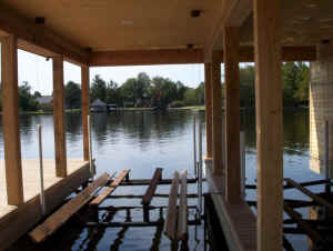 Photograph of a beautiful boat lift built by Vines Piers, Inc., on a beautiful Louisiana bayou